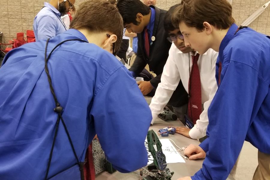 VEX Team - 4 members of the Battlefield TSA VEX Robotics team preparing for competition at the Technosphere 2019 competition held in Hampton, Virginia in May 2019.